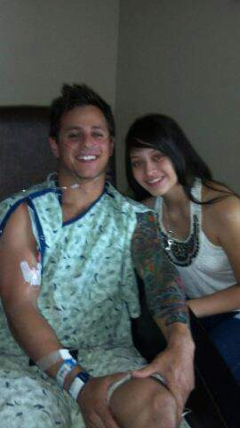 "Shooting victim Carey Rottman with Stephanie Rodriguez, who he says is ""my hero!!"""